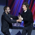 Paul McCartney, right, hands the trophy to Ringo S